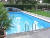 Zwembad 1000 x 500 cm met overkapping